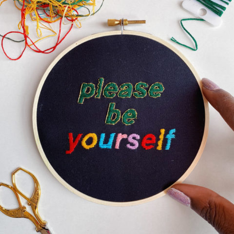 """embroidery pattern composed of text that reads """"Please be yourself"""""""